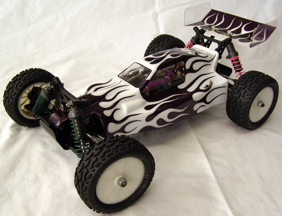 Team-Losi-XXX4-XXX-4-Graphite-with-Purple-Flames-Overall-Left